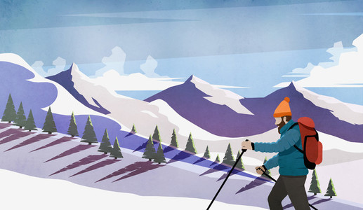 Man cross country skiing among snowy mountains