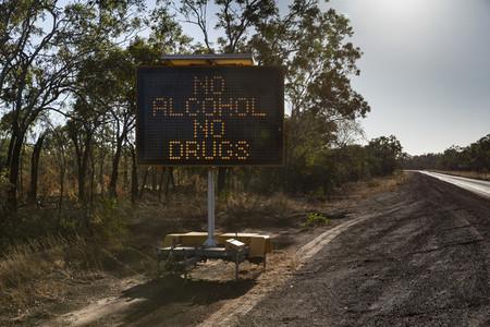 No Alcohol No Drugs digital road sign at sunny roadside