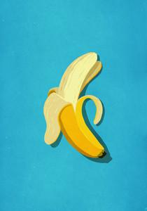 Peeled banana on blue background