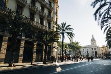 People walking around Plaza del Ayuntamiento  Valencia  Spain