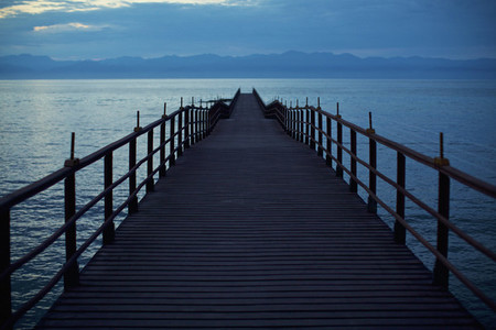 Pier extending over tranquil ocean Punta de Mita Nayarit Mexico
