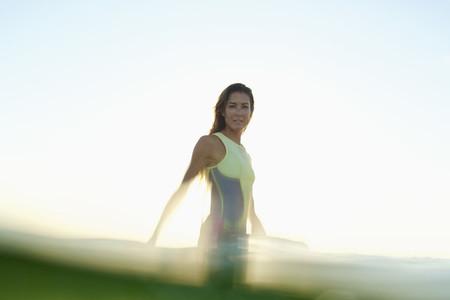 Portrait confident female surfer in ocean