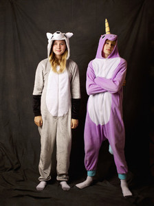 Portrait confident girls in animal costume pajamas
