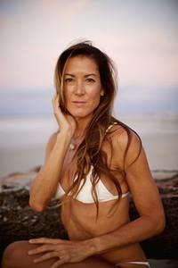 Portrait confident woman in bikini on beach