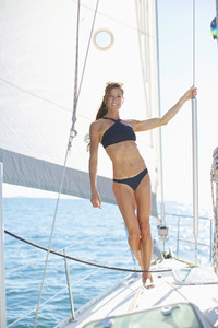 Portrait confident woman in bikini on sunny sailboat 01