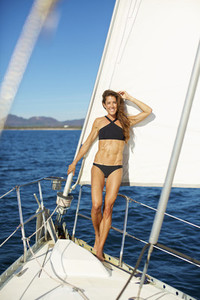Portrait confident woman in bikini on sunny sailboat 02