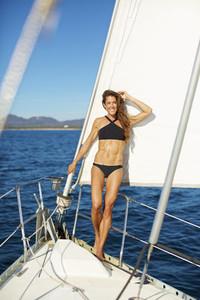 Portrait confident woman in bikini on sunny sailboat 02