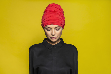 Portrait serene woman wearing headscarf