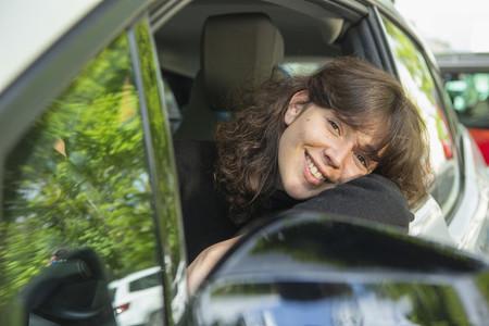 Portrait smiling woman driving car
