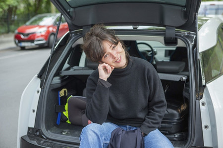 Portrait smiling young woman sitting at back of car