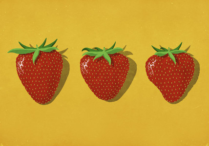 Red strawberries on vibrant yellow background