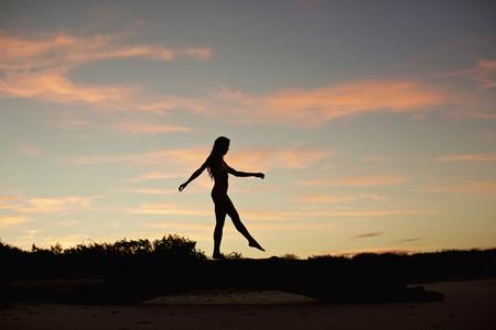Silhouette woman on beach at dusk 01