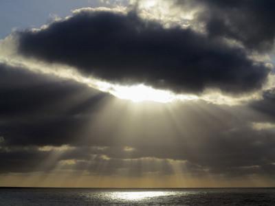 Sunbeams breaking through stormy sky over ocean Santa Cruz de La Palma Spain
