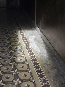 Sunlight on patterned tile floor