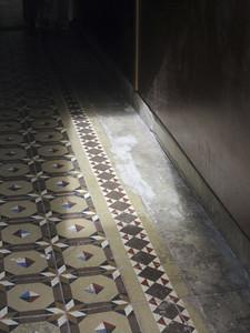 Sunlight on patterned tile floor