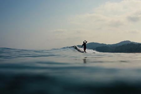 Surfer riding ocean wave  Sayulita  Nayarit  Mexico