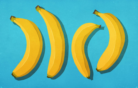 Unpeeled bananas on blue background