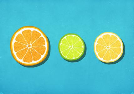 Vibrant citrus slices on blue background