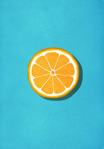 Vibrant orange slice against blue background