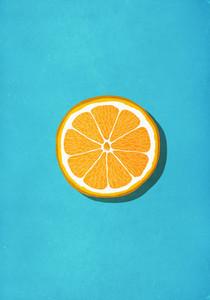 Vibrant orange slice against blue background