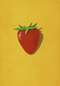 Vibrant red strawberry on yellow background