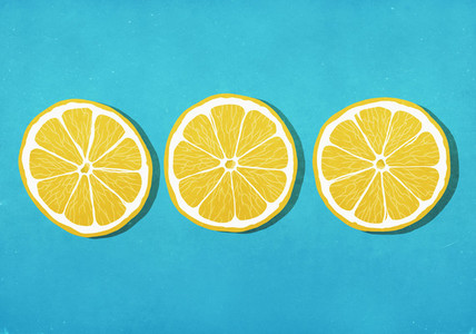Vibrant yellow lemon slices against blue background