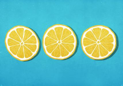 Vibrant yellow lemon slices against blue background