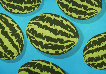 Whole watermelons on blue background