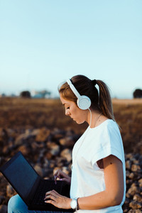 Young woman with her laptop listened external communications