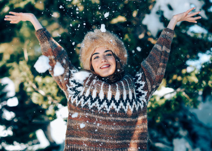 Young woman enjoying the snowy mountains in winter