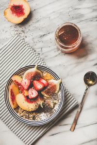 Healthy vegetarian breakfast bowl with yogurt fruits and honey