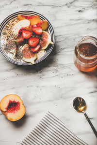 Healthy breakfast with yogurt  fruits and honey  copy space