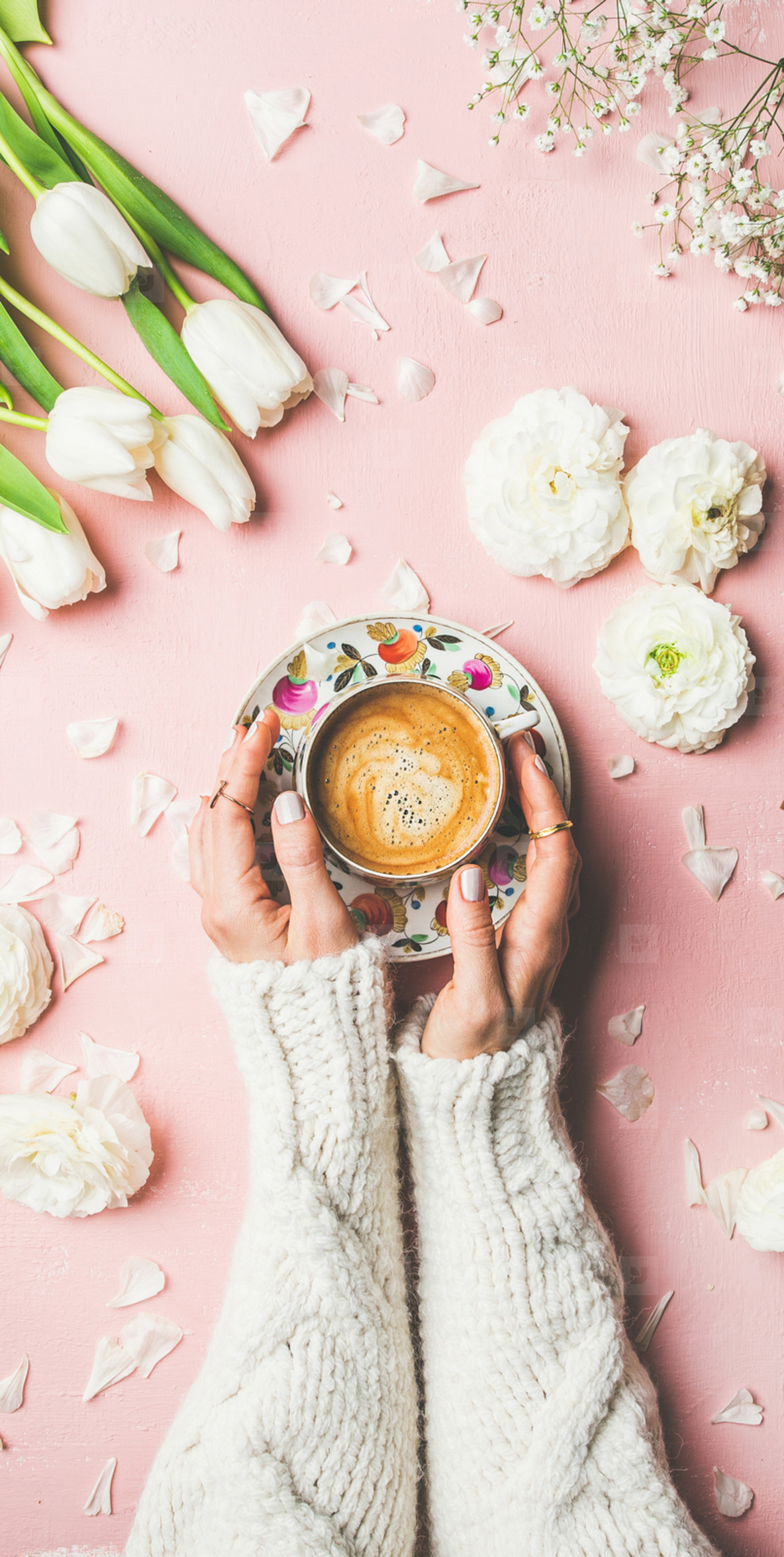 Spring layout with Coffee in female hands and white flowers