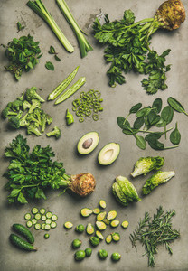 Flat lay of whole and cut vegetables and herbs  top view