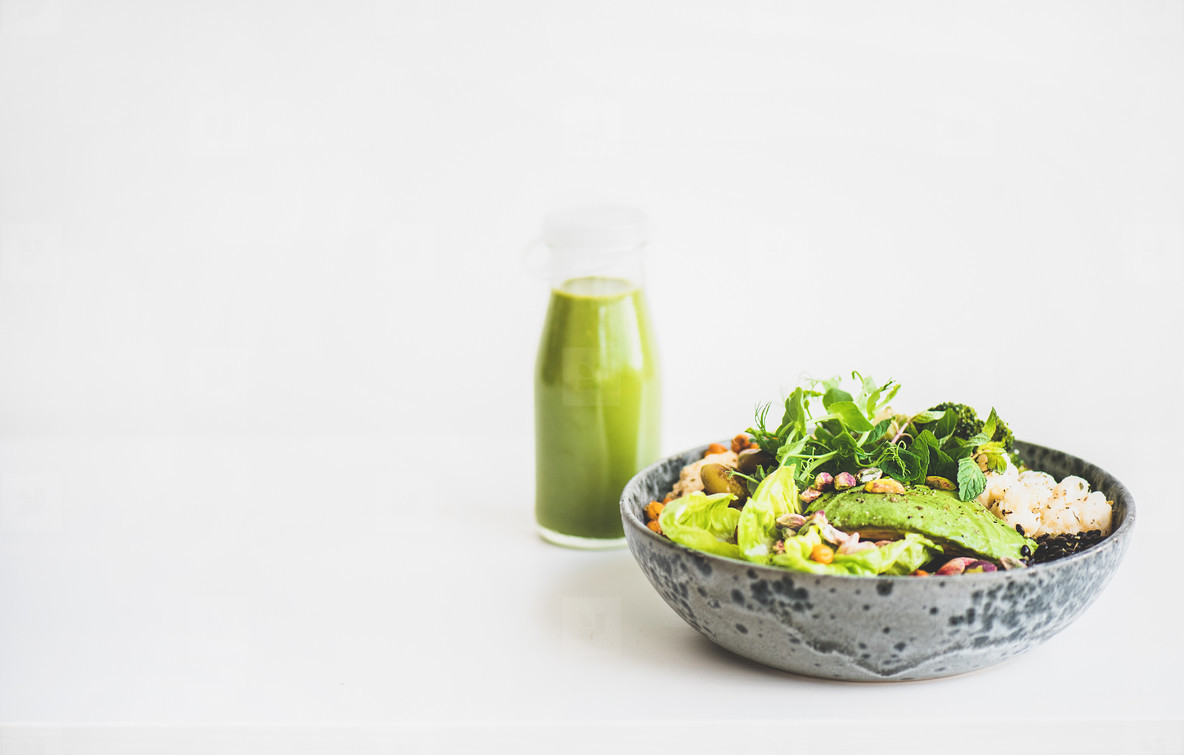 Healthy vegan superbowl and green smoothie  copy space