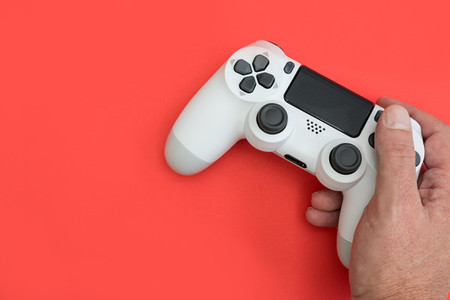 Video games man playing white gaming controller in hands isolate