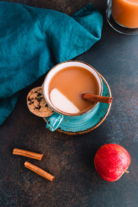 Wintertime chai spiced apple cider with assam tea  cinnamon  ginger  cardamom and almond milk  Christmas or Thanksgiving still life