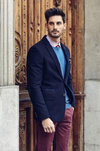 Attractive man wearing british elegant suit in the street Modern hairstyle