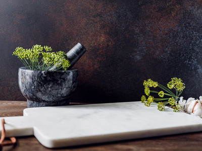 Kitchen table with white marble tray  mortar and herbs  Background for text