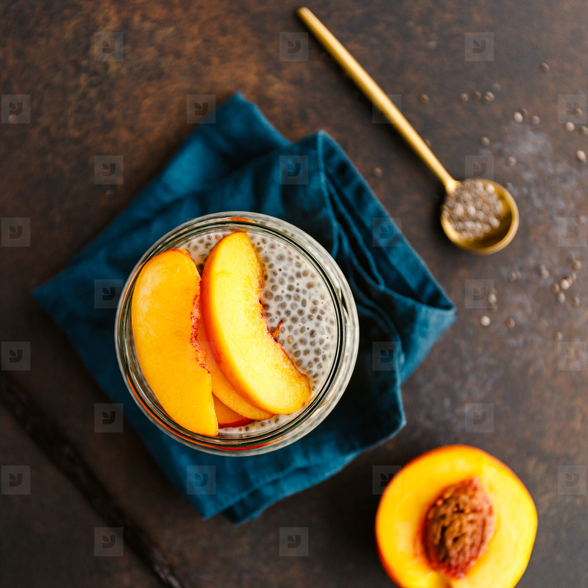 Top view of a portion healthy vegan chia pudding with almond milk  vanilla and peaches in a glass jar