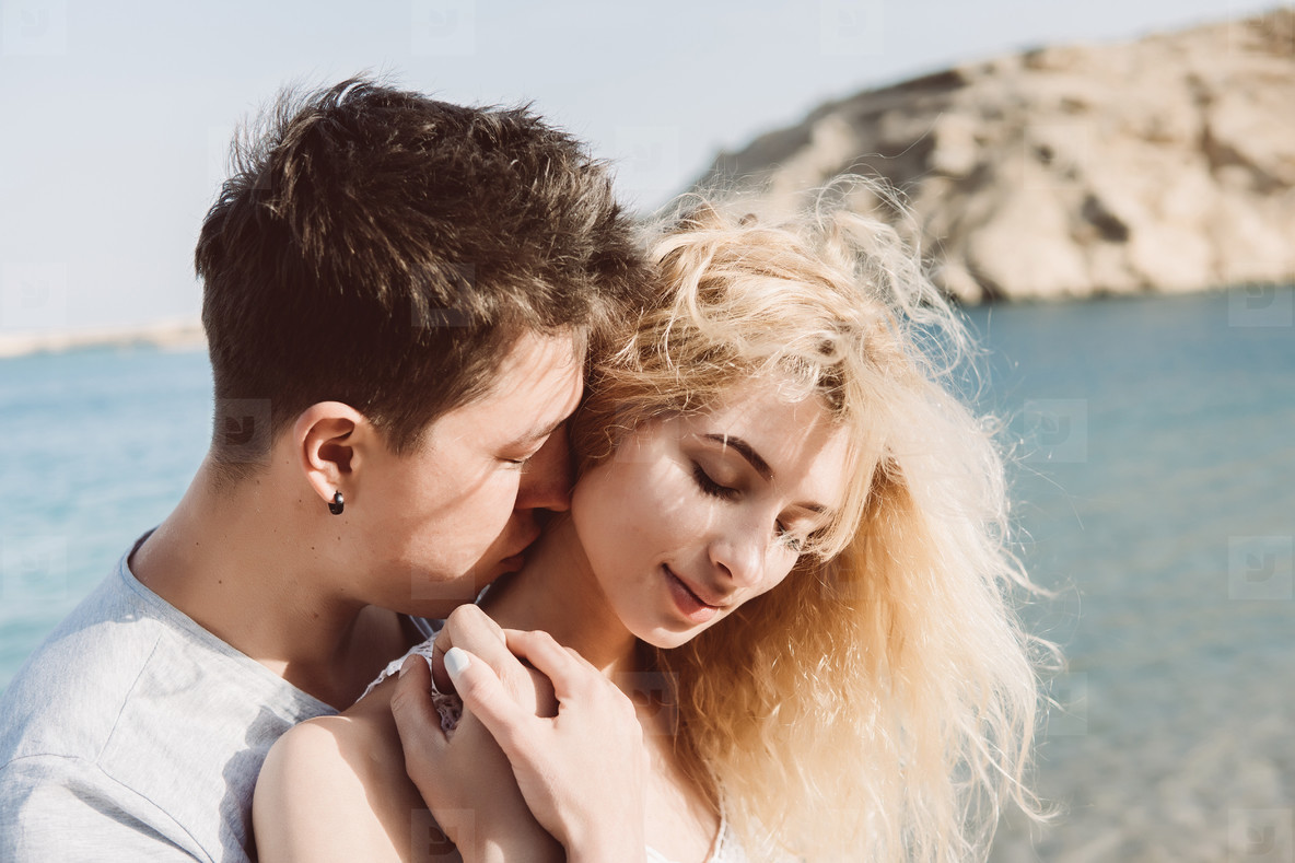 Close up of guy hugging her girlfriend