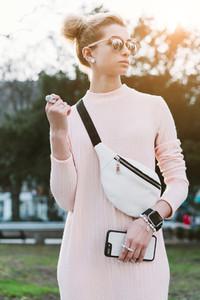 Young and beautiful blonde caucasian girl walking