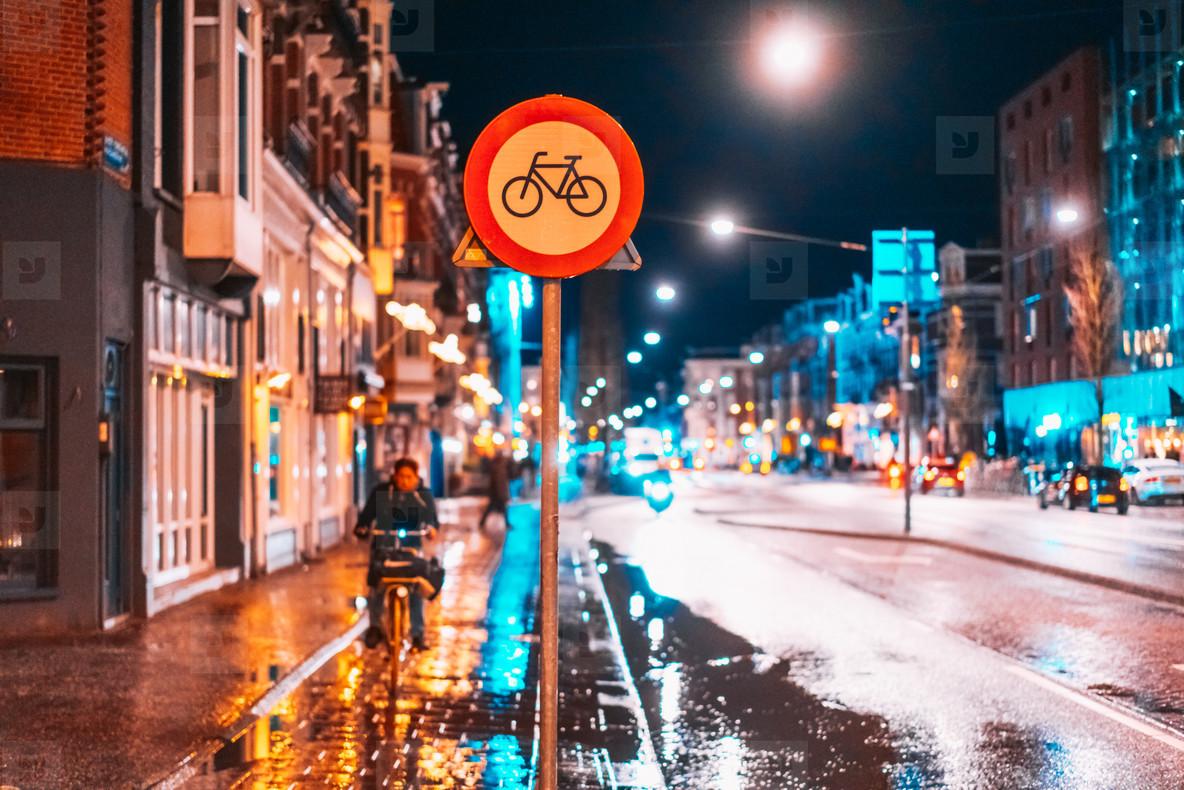 Bicycle lane sign on a night street