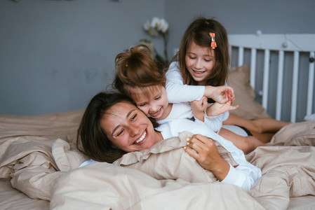 Mom and her two little cute daughters are having fun
