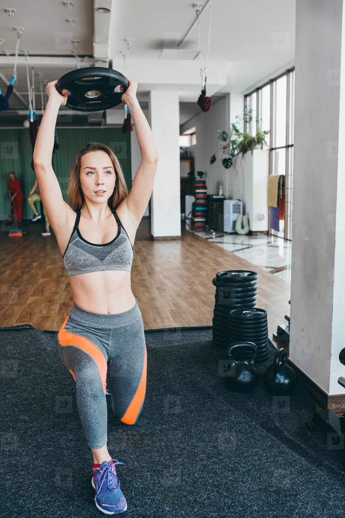 Athletic woman doing exercises in the gym