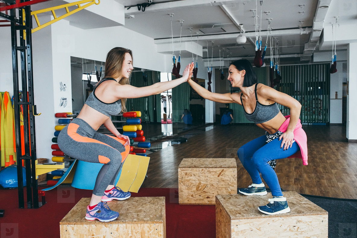 Two beautiful girls in a fitness