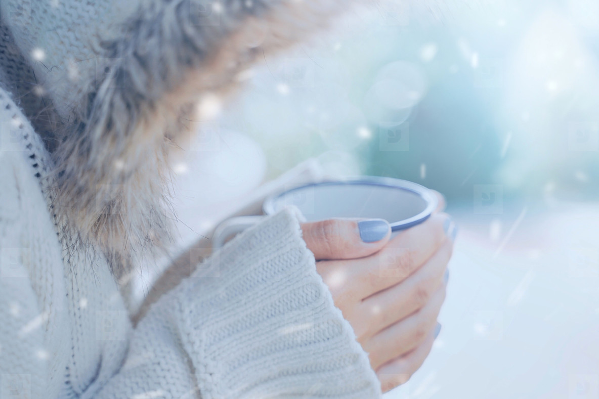 hot cup of coffee in snow