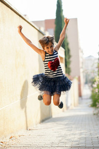 Little girl  eight years old  jumping outdoors