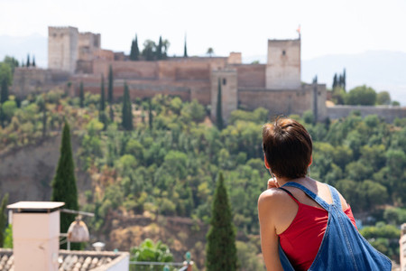 Rear view of woman looking at the Alhambra of Granada