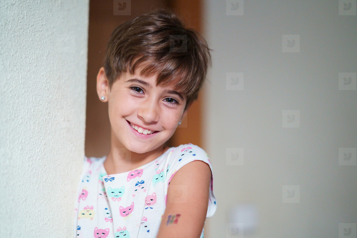 Adorable little girl  eight years old  staring smiling to camera